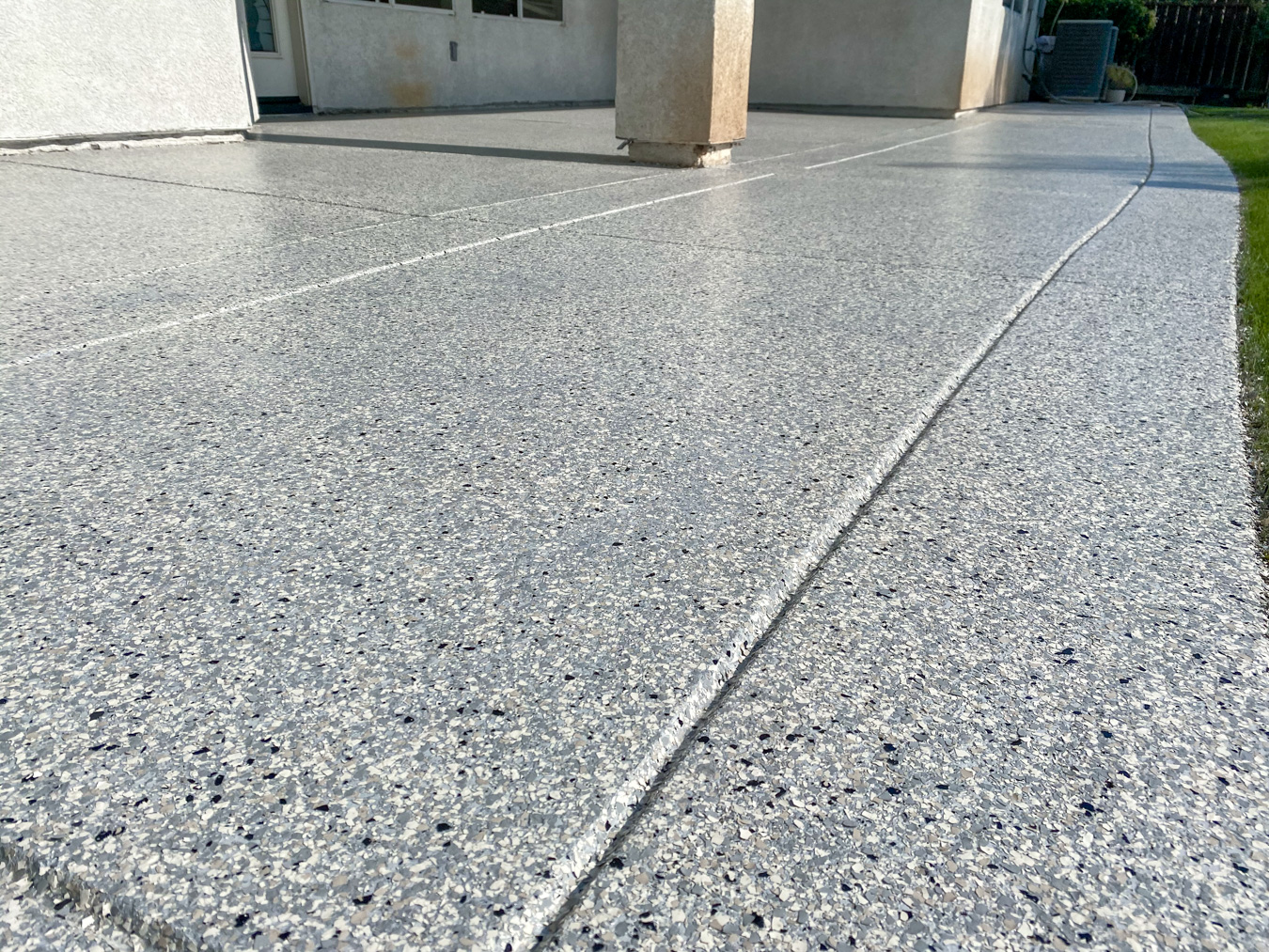 Close-up of deck after gray epoxy concrete coating applied