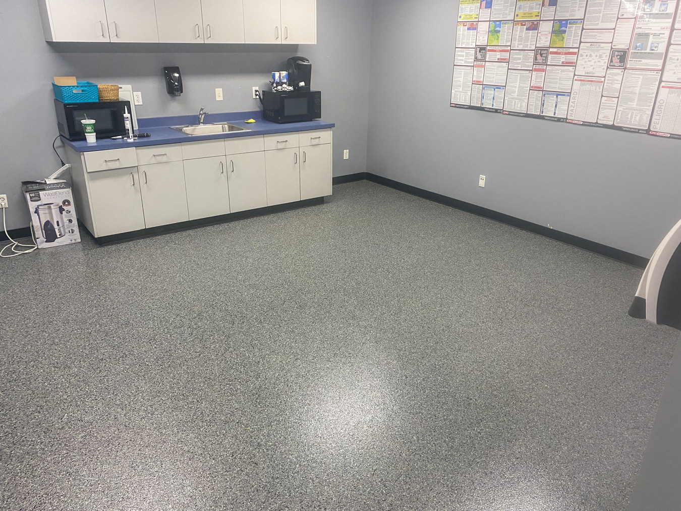 Concrete epoxy coating in a staff work room