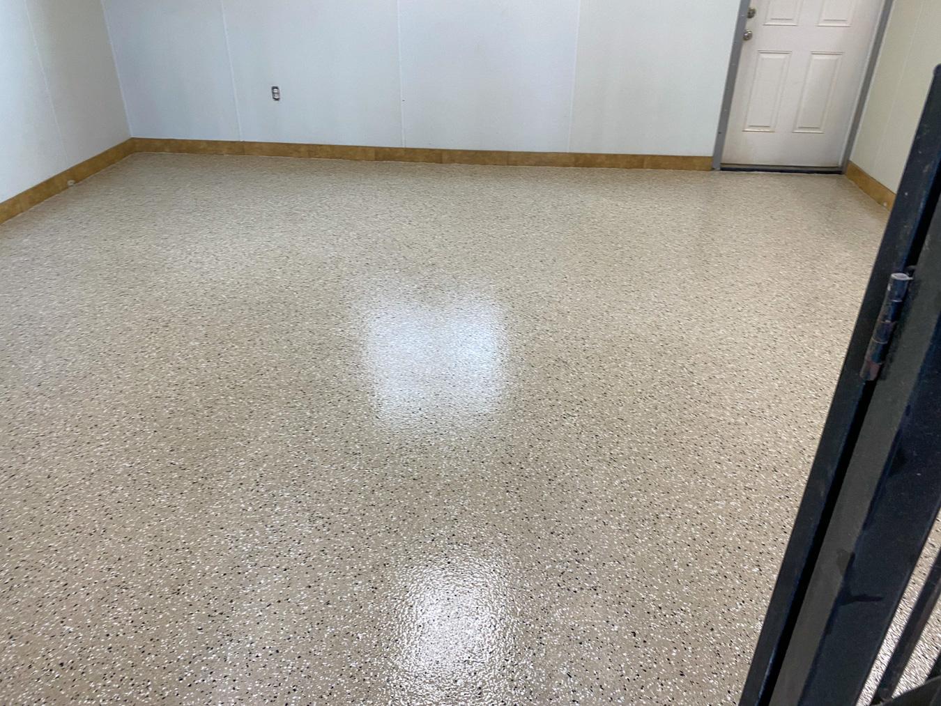 Tan concrete epoxy coating in a storage room