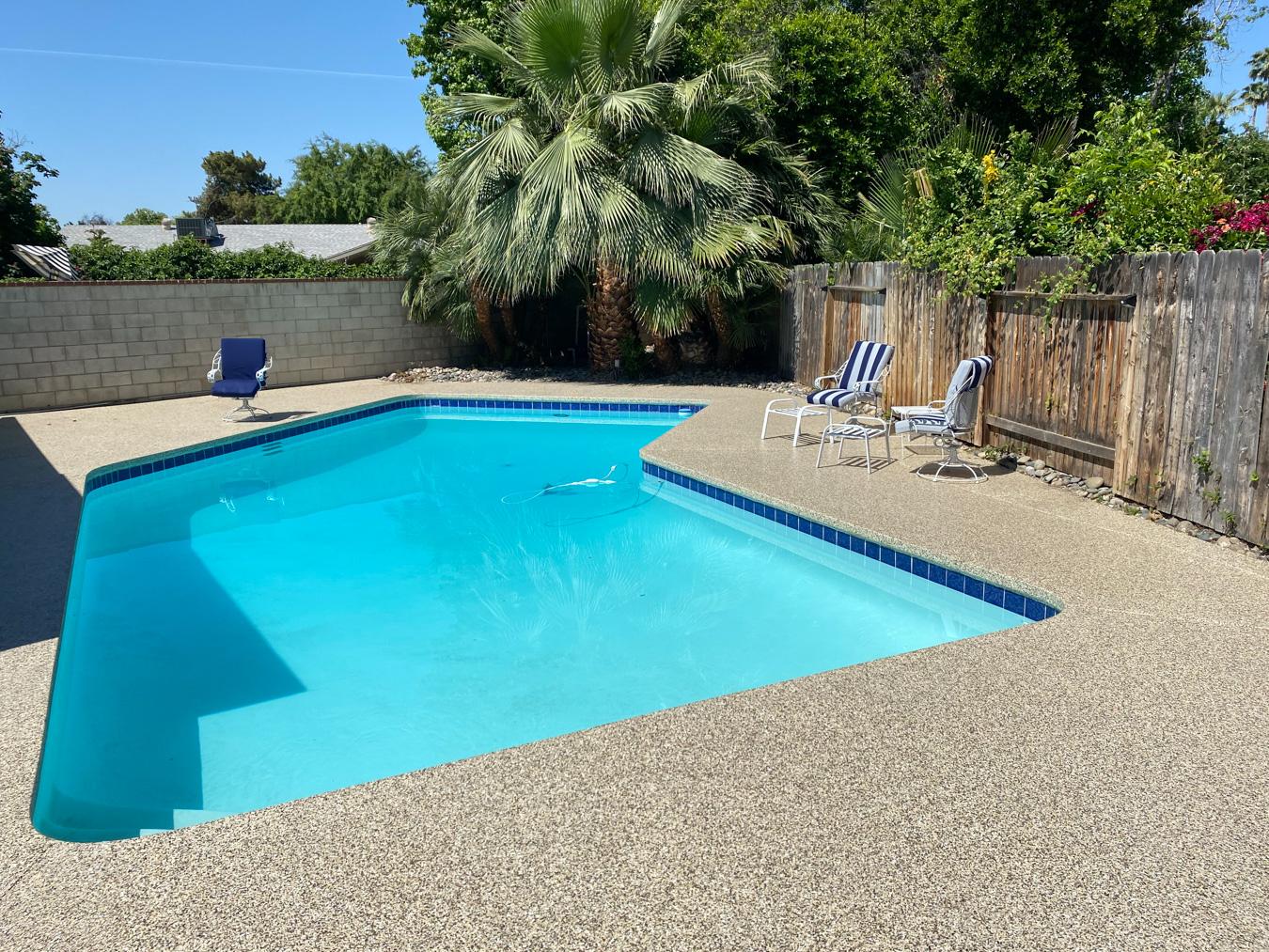 Pool with tan concrete epoxy coating
